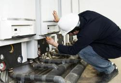 Wyoming IA HVAC tech servicing industrial furnaces
